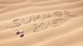 Summer 2015 handwriting on the sand Royalty Free Stock Images