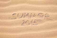 Summer 2015 handwriting on the sand Royalty Free Stock Image