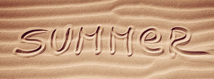 Summer handwriting on the sand Stock Images