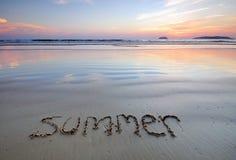 Summer handwritten on a beach Stock Photo