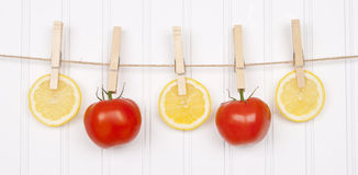 Summer Hanging Lemon Slices and Tomatoes Stock Photos