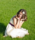 Summer happiness. Pretty girl sitting on grass and smile, summer happiness Royalty Free Stock Photos