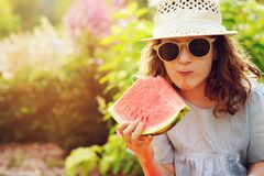 summer happy child girl eating watermelon outdoor on vacation Royalty Free Stock Images