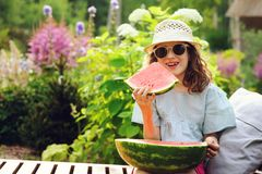 summer happy child girl eating watermelon outdoor on vacation Royalty Free Stock Photography