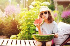 Summer happy child girl eating watermelon outdoor on vacation Stock Photos