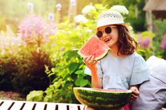Summer happy child girl eating watermelon outdoor on vacation Stock Images