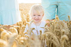 Summer happy portrait of son with parents. Image of happy kid in field Royalty Free Stock Photography