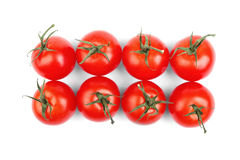 Summer harvest of bright red tomatoes with green leaves  on a white background. Vegetables. Juicy, ripe and fresh tomatoes Royalty Free Stock Image
