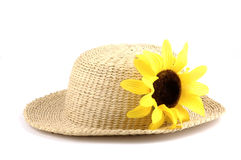 Summer Hat. Straw hat with a bright yellow sunflower Stock Photography
