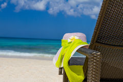 Summer hat on beach chair, tropical vacation Stock Photo