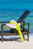 Summer hat on beach chair, tropical vacation Stock Images