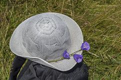 Summer hat decorated with flower bell or campanula patula on a backpack  in the Vitosha mountain. Bulgaria royalty free stock photo