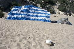 Summer hat and greek flag. Painted on rock stock photo