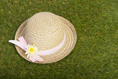 Summer hat lying on grass Royalty Free Stock Image