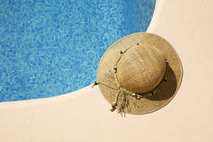 Summer hat at the poolside Stock Photos