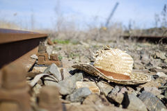 Summer hat on rails  Royalty Free Stock Photo