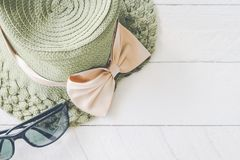 Summer hat with  sunglasses on white wooden. Background Stock Images