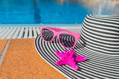 Summer hat at the swimming pool Royalty Free Stock Photos