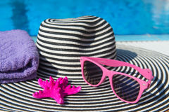 Summer hat at the swimming pool Royalty Free Stock Photo