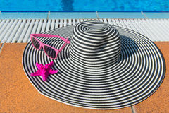 Summer hat at the swimming pool Stock Image