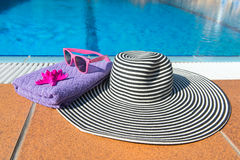 Summer hat at the swimming pool Royalty Free Stock Image