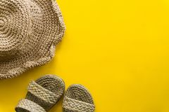 Summer hat weave and sandal weave with yellow background stock image