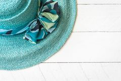 Summer hat on white wooden. Background Royalty Free Stock Photo