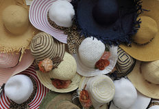 Summer hats. Close-up image of a street stand selling various types of summer hats Stock Image
