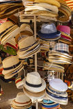 Summer hats hanging on a hanger in the store Stock Images