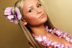 Summer/hawai girl on gold background Royalty Free Stock Photo