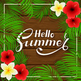 Summer Hawaiian flowers on wooden background Stock Photo