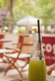 Summer heat. Green apple juice in a bottle Stock Photography