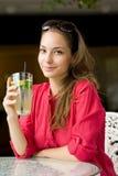 Summer heat refreshment. Summer heat refreshment, grogeous young brunette drinking lemonade Stock Image