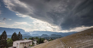 Summer heat storm over Lesce, Slovenia. Taken from the roof of an appartment building Royalty Free Stock Photo