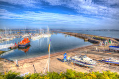 Summer 2013 heat wave Devon Brixham habour UK with calm blue sea and sky in HDR Royalty Free Stock Images