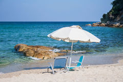 Summer heaven. Lounges and sun umbrella on  beach Royalty Free Stock Photo