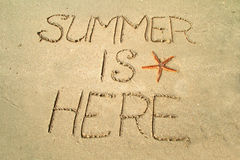 Summer is here. Message in the sand Royalty Free Stock Photography