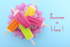Summer is Here concept with bright color ice creams Royalty Free Stock Image