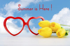 Summer Is Here concept with red heart shape sunglasses Stock Photo