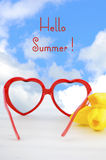 Summer Is Here concept with red heart shape sunglasses Royalty Free Stock Image