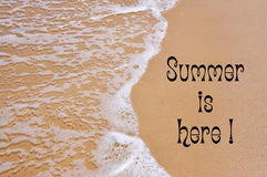 Summer is Here writing on sandy beach Royalty Free Stock Images