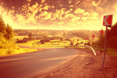 Summer highway turn olrange sky Royalty Free Stock Photo