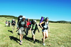 Summer hiking. Backpackers going up in Crimean mountain Royalty Free Stock Photography