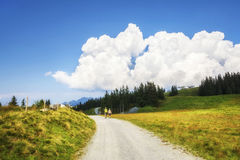 Summer hiking experience in the Alps mountains Royalty Free Stock Image