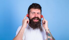Summer hit concept. Man bearded hipster red ripe strawberry ears as headphones. Summer playlist music. Guy enjoy juicy. Sound summer hit song music. Hipster stock photos