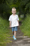Summer hlidays: little boy in the wood Stock Image