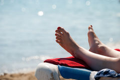 Summer holdays. Sunbathing at the beach during summer holidays Royalty Free Stock Images