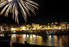 Summer Holiday. Mid-august holiday fireworks over sea by night, Marina of Camerota, Italy Royalty Free Stock Photos