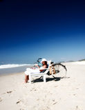 Summer holiday. Woman on beach chair at beach Stock Image