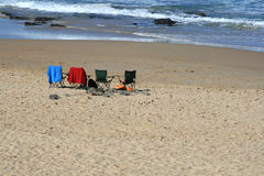 Summer holiday. Four chairs on teh beach on a hot summer day Stock Photo